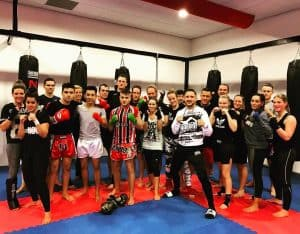 A photo of Andy Souwer at his gym with a group of students at one of his Dutch Kickboxing Gyms