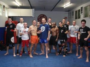 A photo of Andre Mannaart and a group of his students at one of his Mejiro Dutch Kickboxing Gyms
