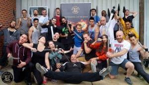 A photo of Warrior Collective Blogger Stuart Tomlinson posing with the rest of his group upon completion of the Martial Arts based Screen Combatant Course at the British Action Academy in Surrey