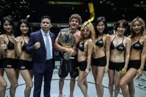 A photo of Ben Askren holding the One World Championship Belt