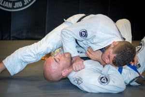 A photo of Charles Negromonte demonstrating BJJ Side Control Submissions