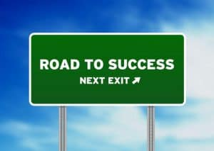 A sign saying road to success showcasing the blog successful martial arts gym