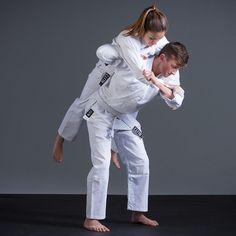 A photo of two white belts training from the blog post on tips from the top