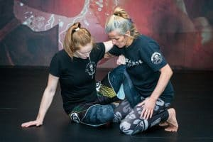 A photo of leg locks in action from the Combat Base Darren and Helen Currie BJJ volume Simplifying Leg Locks