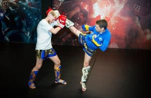A photo of Damien Trainor throwing a kick taken from his Muay Thai Instructional The Fight Game