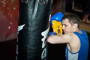 A photo of Damien Trainor Solo Training doing Bag Work on the Fairtex 6ft Banana Bag