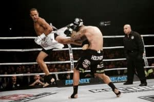 A photo of Raymond Daniels executing a spin back kick mid fight