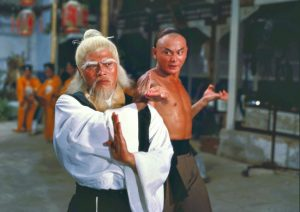 A photo of an old chinese master winning the hardest fight with his student