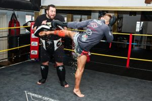 A photo of Jonathan Haggerty faking kicks with Christian Knowles