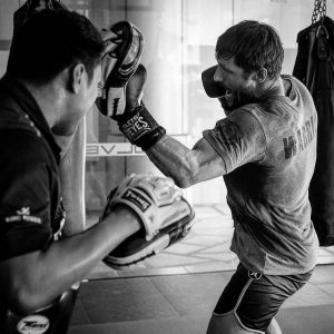 A photo of athletes from on a training camp at Evolve MMA