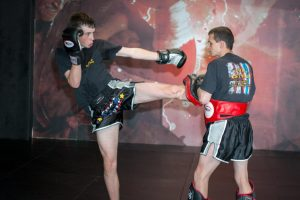 A photo of Darren O'Connor holding Pads from the Advanced Kick Shield Drills Blog Post