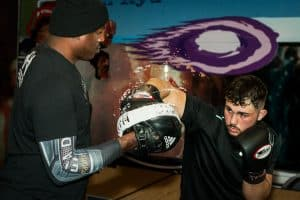A photo of Barry Robinson holding pads from How to Train for World Level Boxing - Fighter Drills