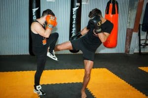 A photo of Jay Jauncey kickboxing sparring countering low kicks