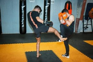 A photo of Jay Jauncey countering low kicks whilst kickboxing sparring
