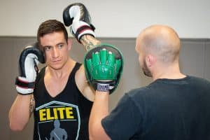 A photo of a fighter demonstrating southpaw to orthodox elite level striking with Kieran Keddle