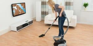 A photo of someone cleaning to demonstrate how to improve your fitness at home