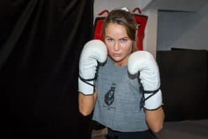 A photo of Praise Vaughn as she demonstrates the cross punch in boxing
