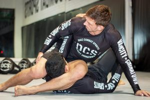 A photo of Stuart Cooper as he showcases his BJJ Pressure Passing System whilst Killing Guard